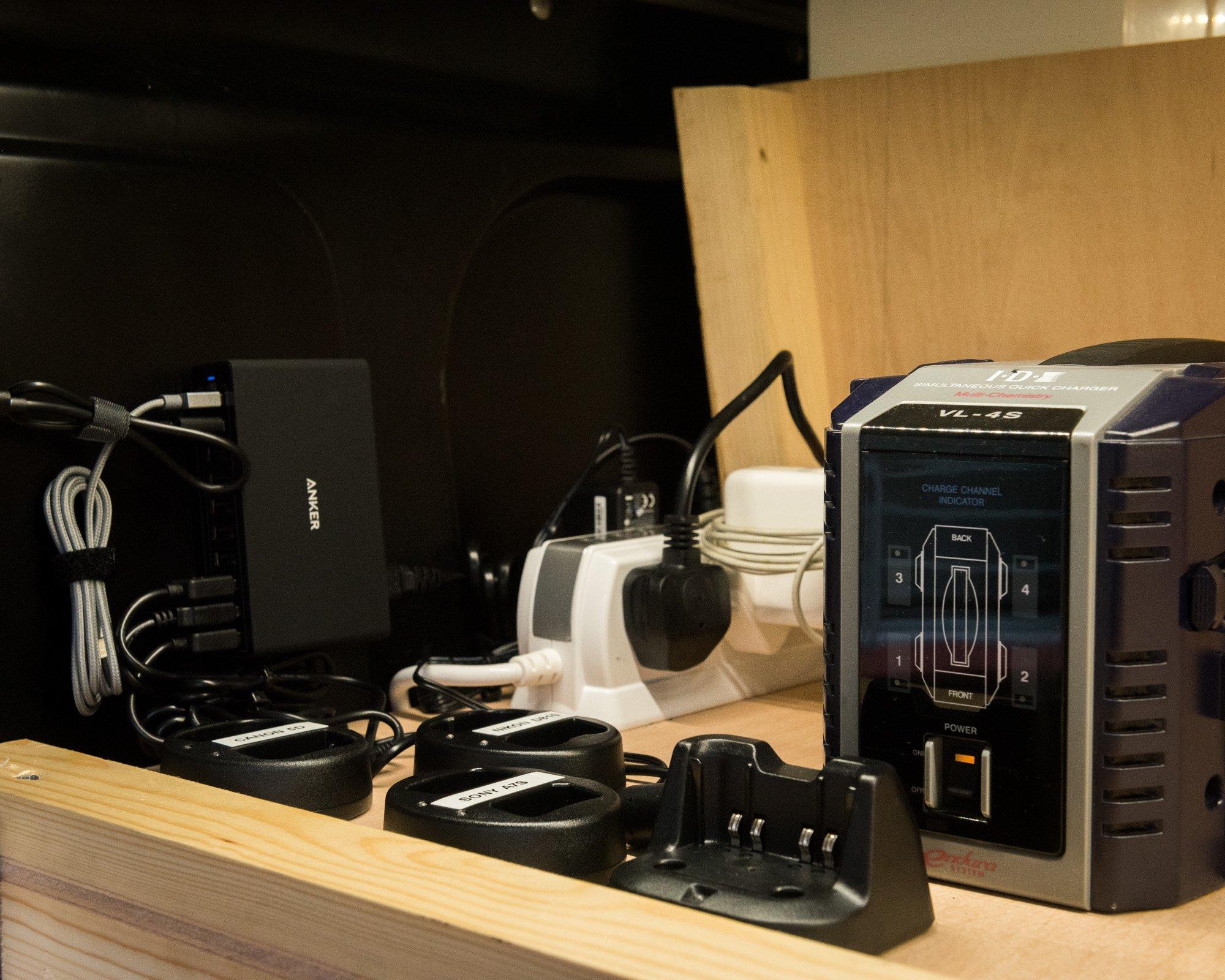 Camera charging station in location filming van